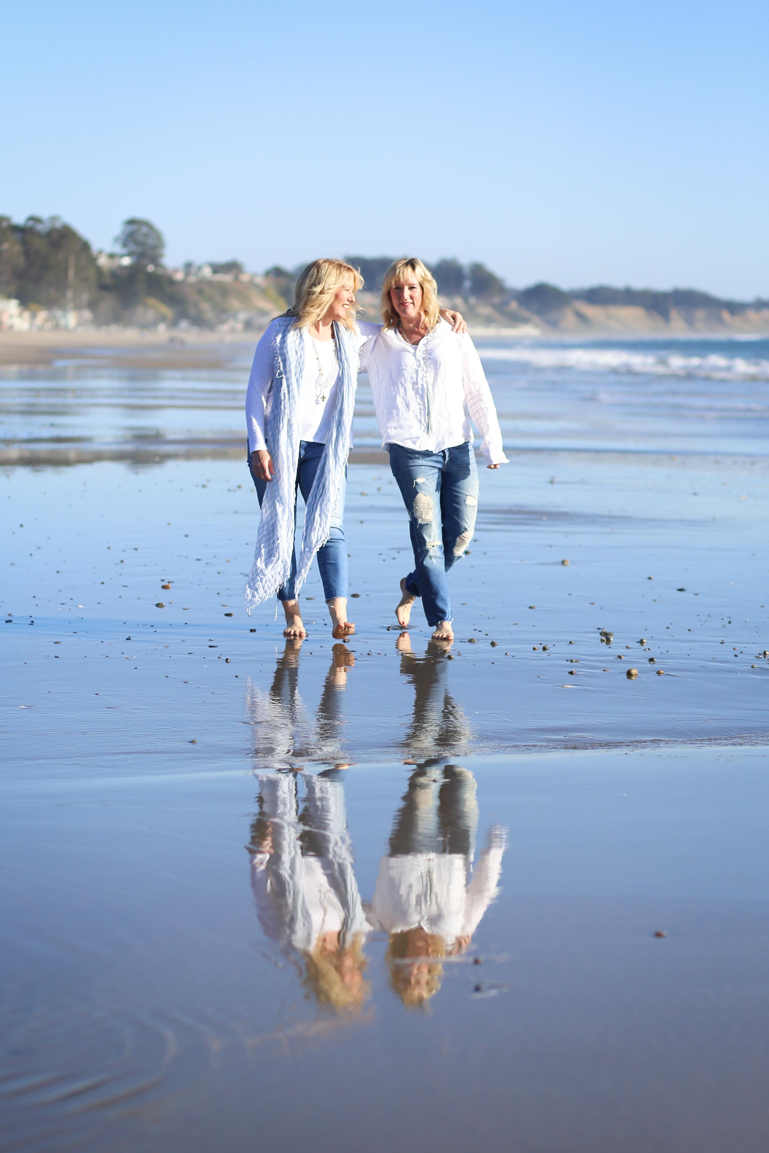 Twins walking on beach