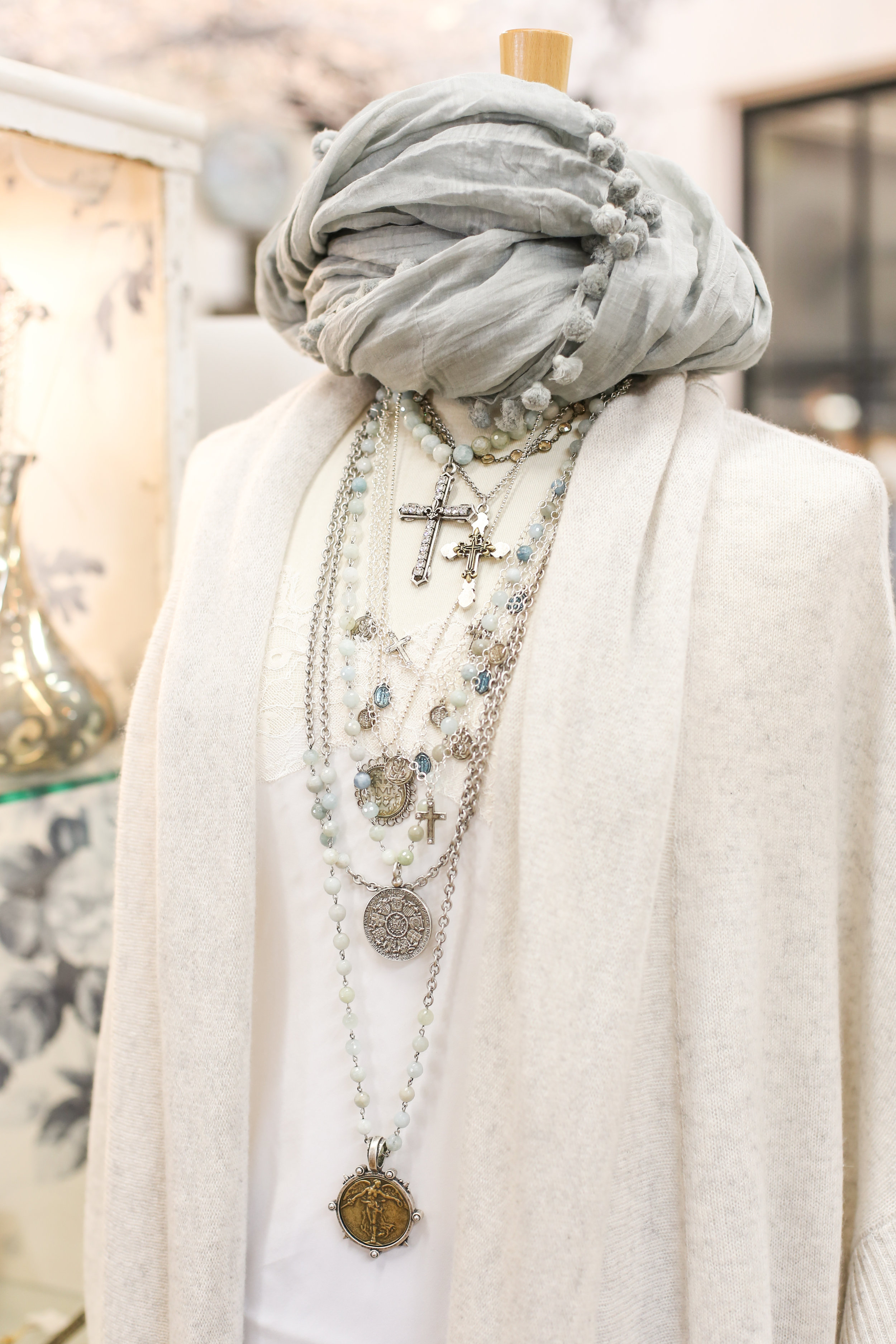 Chic styled ivory cardigan and accessories