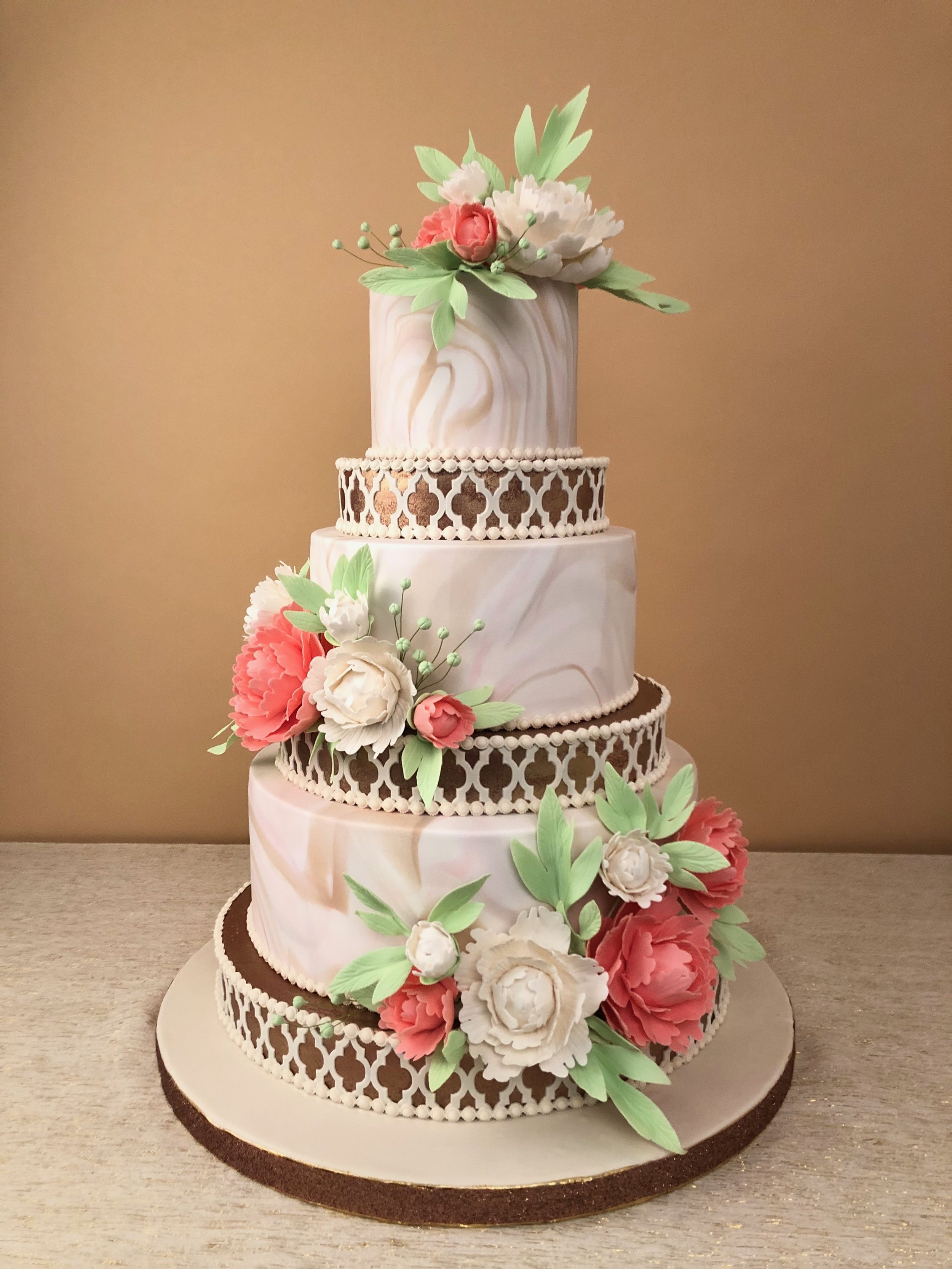 Six-Tiered Wedding Cake With Marbled Accents, Edible Rose Gold and Hand Sculpted Gum Paste Peonies. Published in (201) Best Of Bergen Magazine, February 2019 Issue.