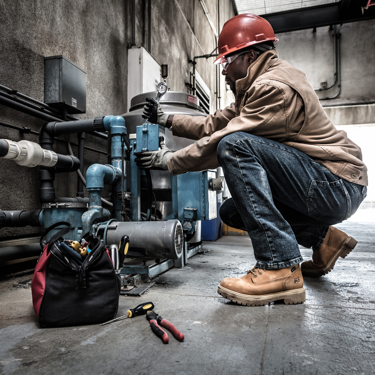 Man in Hard Hat Wearing Work Boots