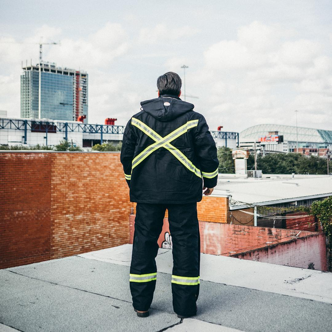Man on Roof Wearing Safety High Visibility Gear
