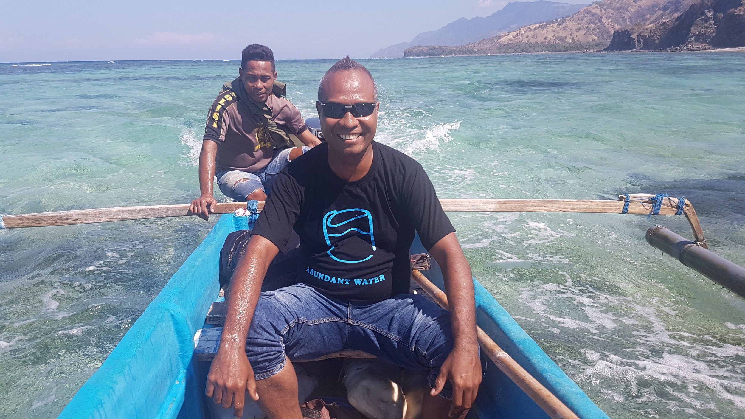 Simao da Costa, the AW Program Manager for Timor-Leste (front), travelling up the coast of Atauro Island.