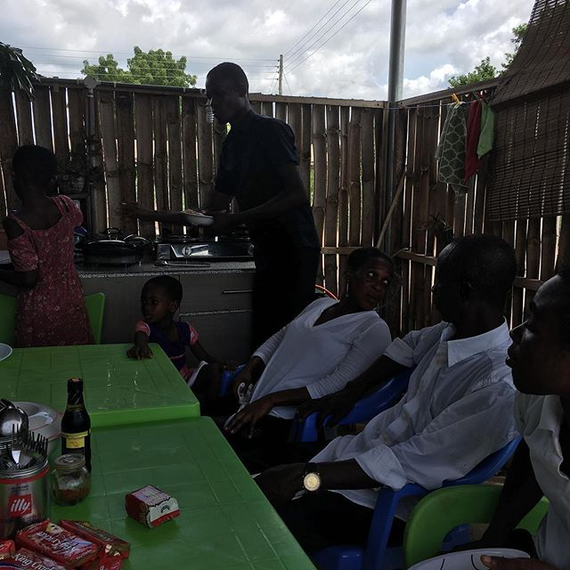 """Here's a post from Therefore missionaries Casey and April Zimmerman. """"FELLOWSHIP: This was a picture of a beautiful Saturday lunch with our spiritual family here in Ghana. We enjoyed a meal of fresh tilapia, fried rice and watermelon together."""""""