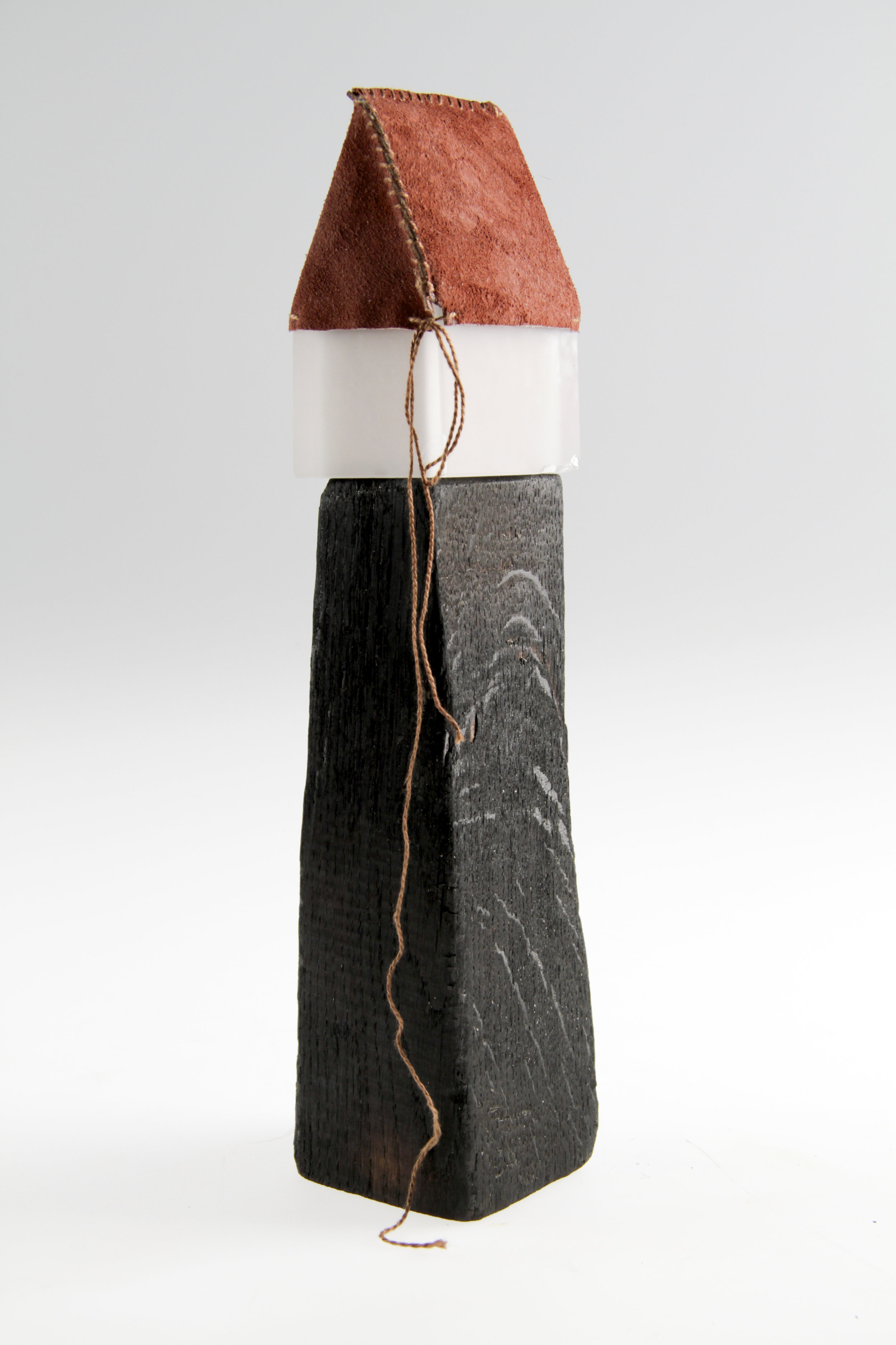 Cast glass, burnt wood, leather and thread. 2011