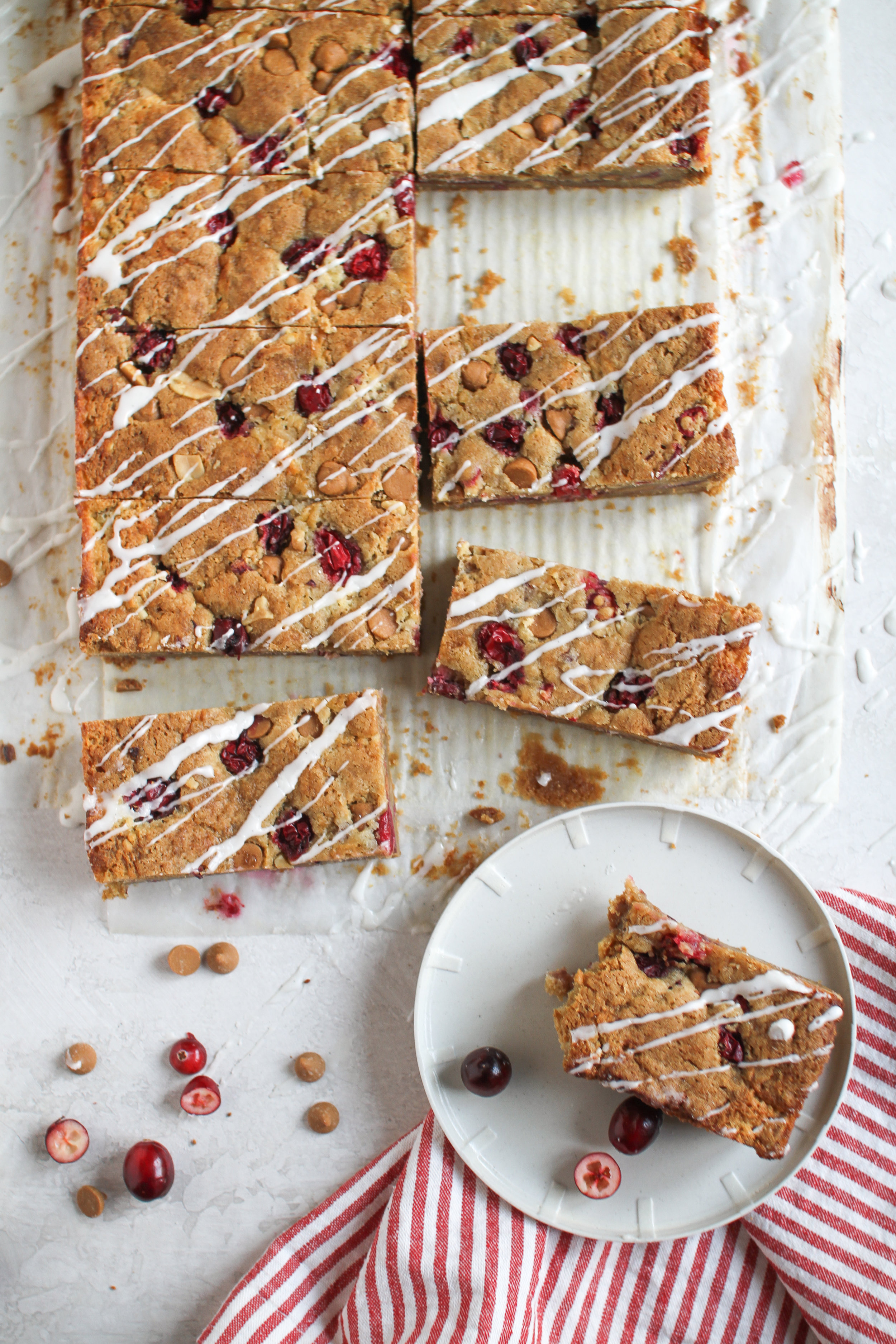 Peanut Butter & Cranberry Jam Mascarpone Cheesecake Cookie Bars with vanilla bean icing by Fox and Crane - foxandcrane.com