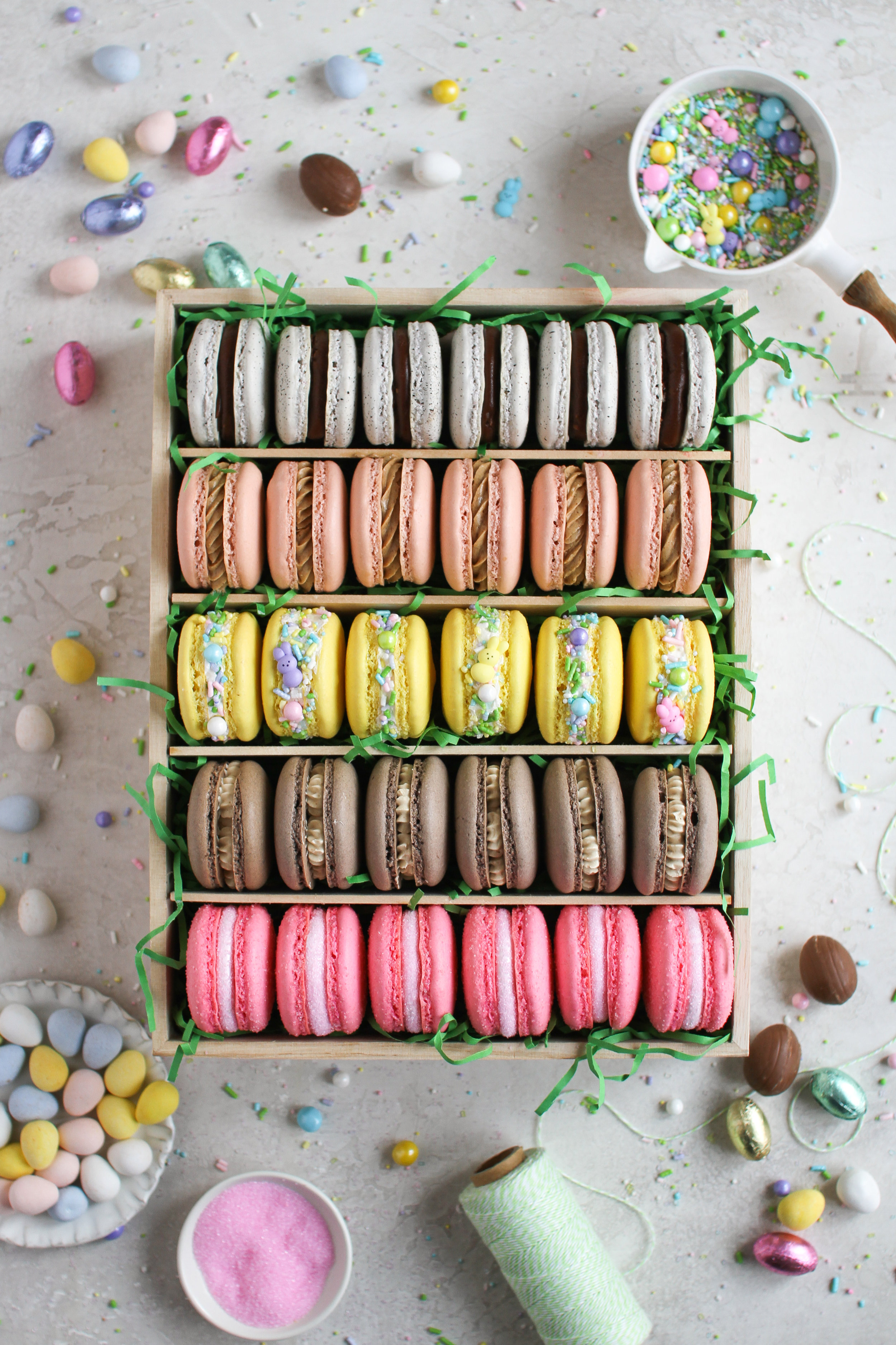 The Ultimate Easter Macarons - classic vanilla shell and chocolate shells filled with peep marshmallow, reeses peanut butter swiss meringue buttercream, cadbury creme egg ganache, hot cross buns spiced german buttercream and coconut vanilla bean swiss meringue buttercream by Fox and Crane - foxandcrane.com
