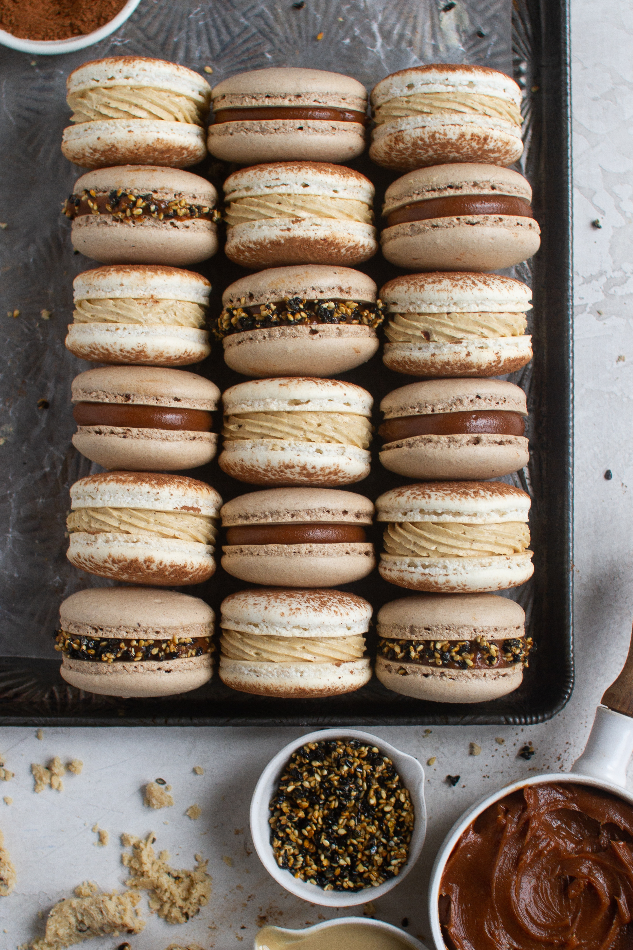 "Sesame Macarons ""two ways"" - Salted Caramel Tahini Milk Chocolate Ganache Macarons with chocolate shells and sesame brittle + Coffee and Halva Macarons with classic vanilla bean shells dusted with cocoa, coffee german buttercream and Seed + Mill coffee halva by Fox and Crane - foxandcrane.com"