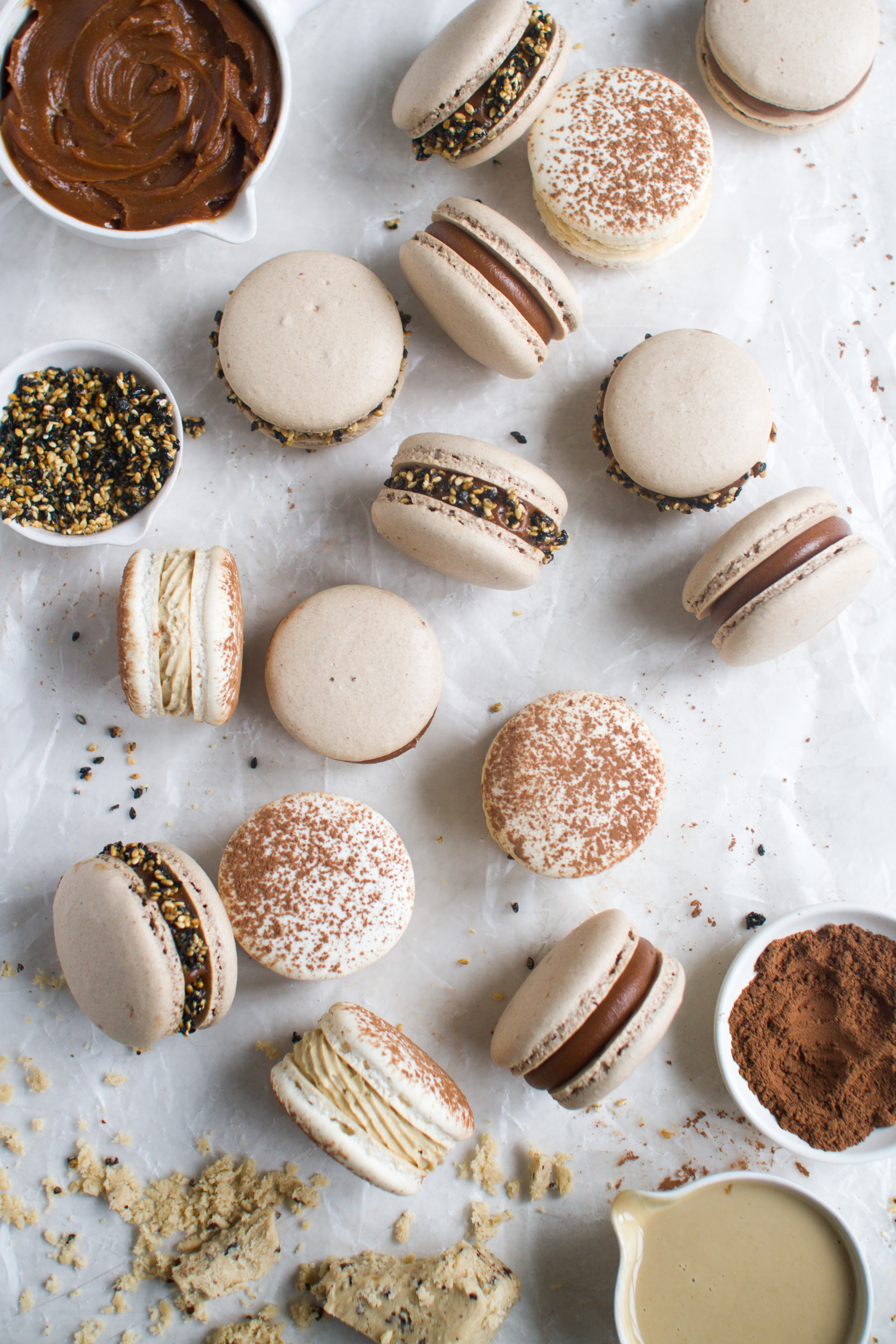 """Sesame Macarons """"two ways"""" - Salted Caramel Tahini Milk Chocolate Ganache Macarons with chocolate shells and sesame brittle + Coffee and Halva Macarons with classic vanilla bean shells dusted with cocoa, coffee german buttercream and Seed + Mill coffee halva by Fox and Crane - foxandcrane.com"""