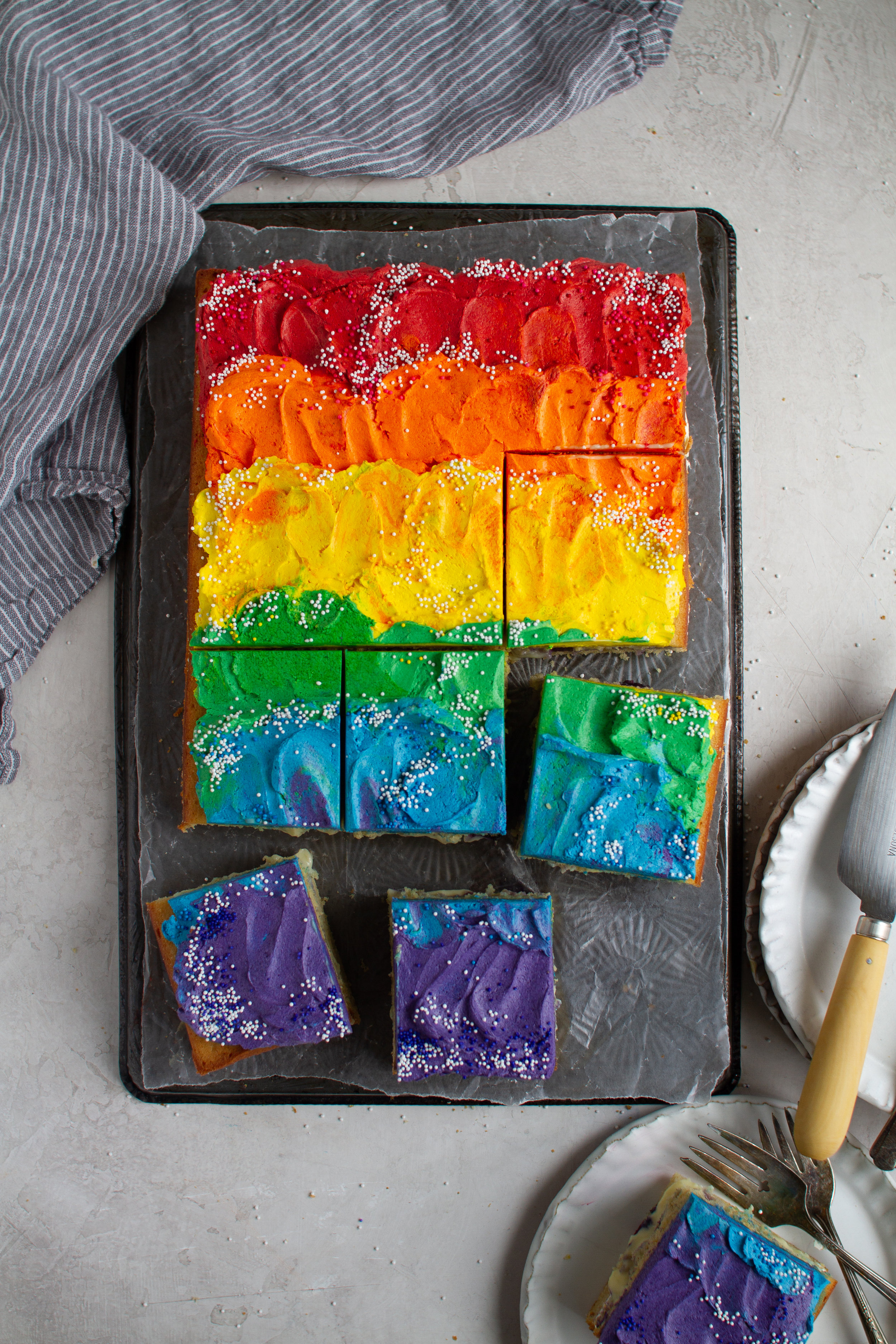 LGBTQ Rainbow Sheet Cake - lemon and ginger cake filled with a fresh blueberry compote, fresh thyme infused custard and finish with a quark cheese german buttercream! by Fox and Crane - foxandcrane.com