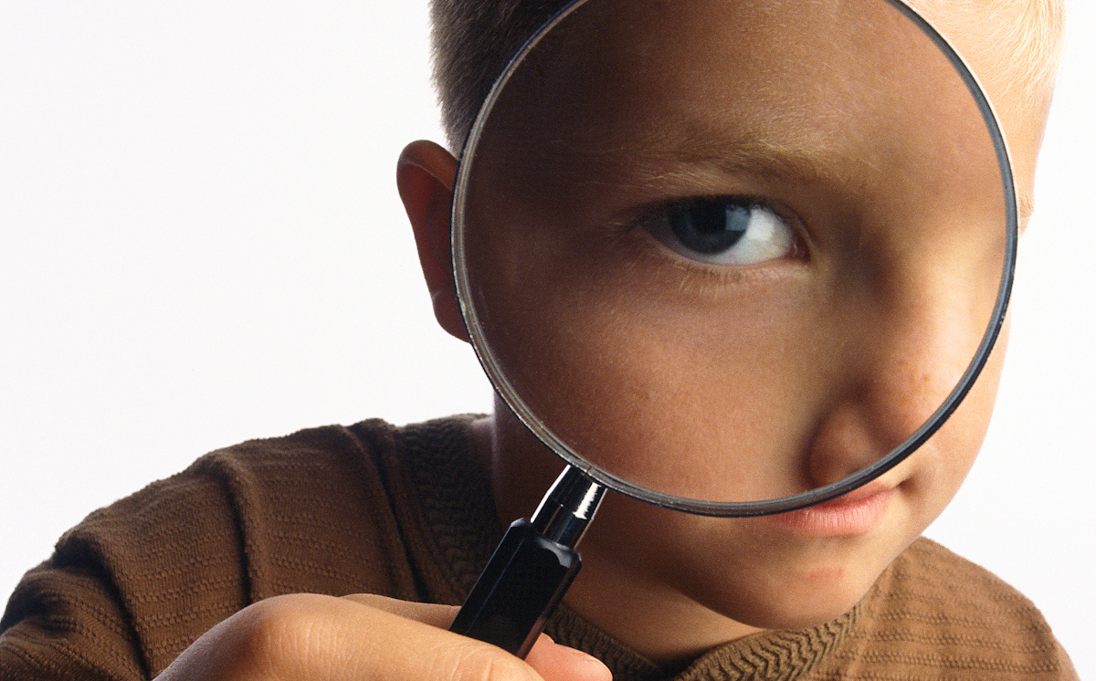 Boy_with_Magnifying_Glass.jpg