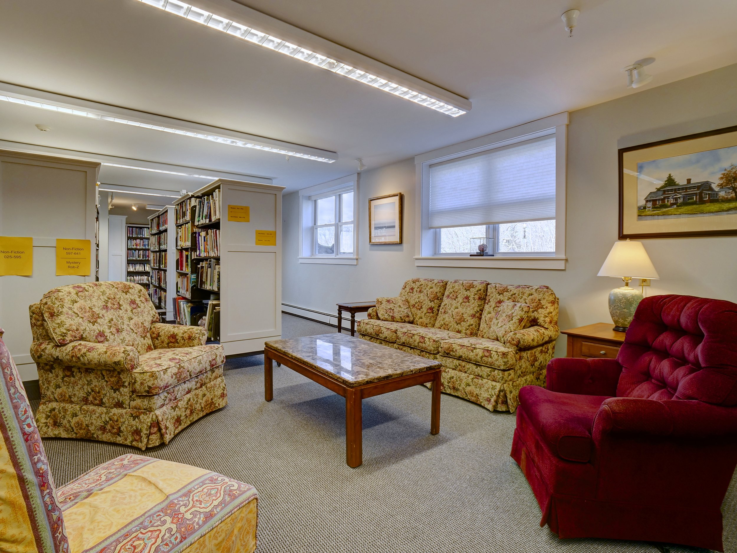 Cozy Gathering Place among the Adult Stacks, including Mysteries, Biographies, Fiction, and Non-Fiction.
