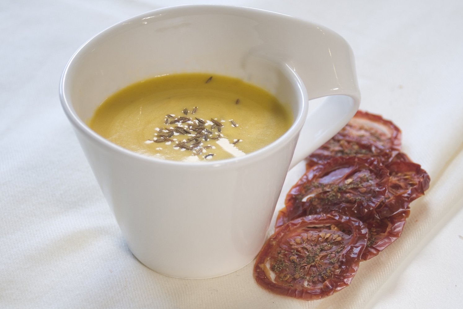 carrot and saffron soup with roasted tomato crisps -