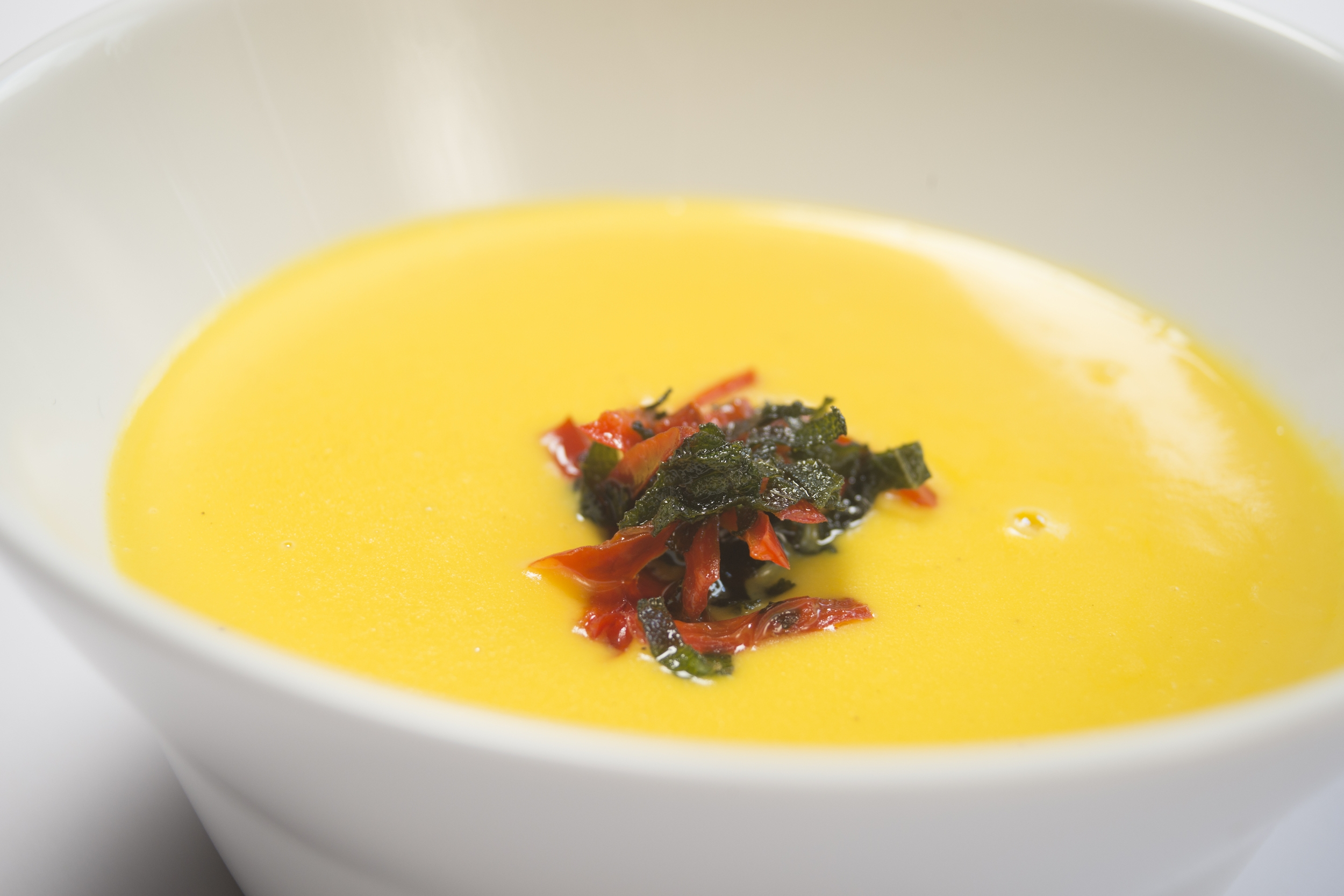 squash and sage soup with red pepper topping -