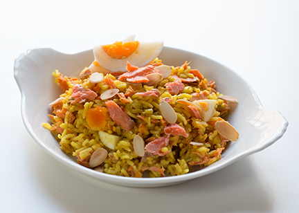 salmon kedgeree with spices and nuts -