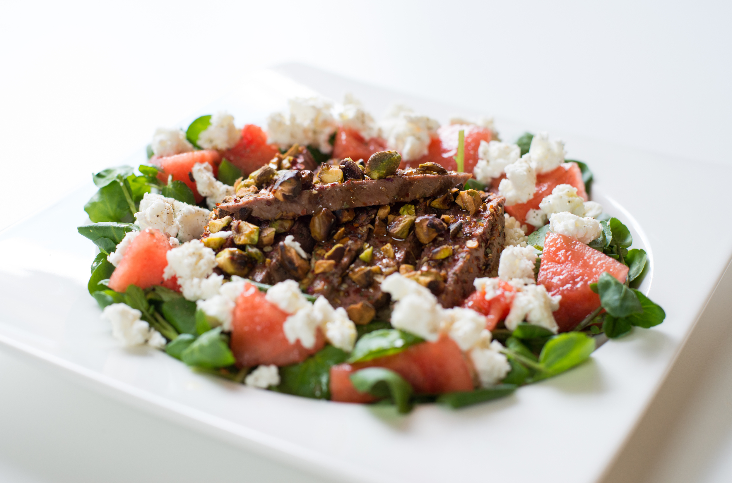 spiced lamb salad with watermelon and nuts -