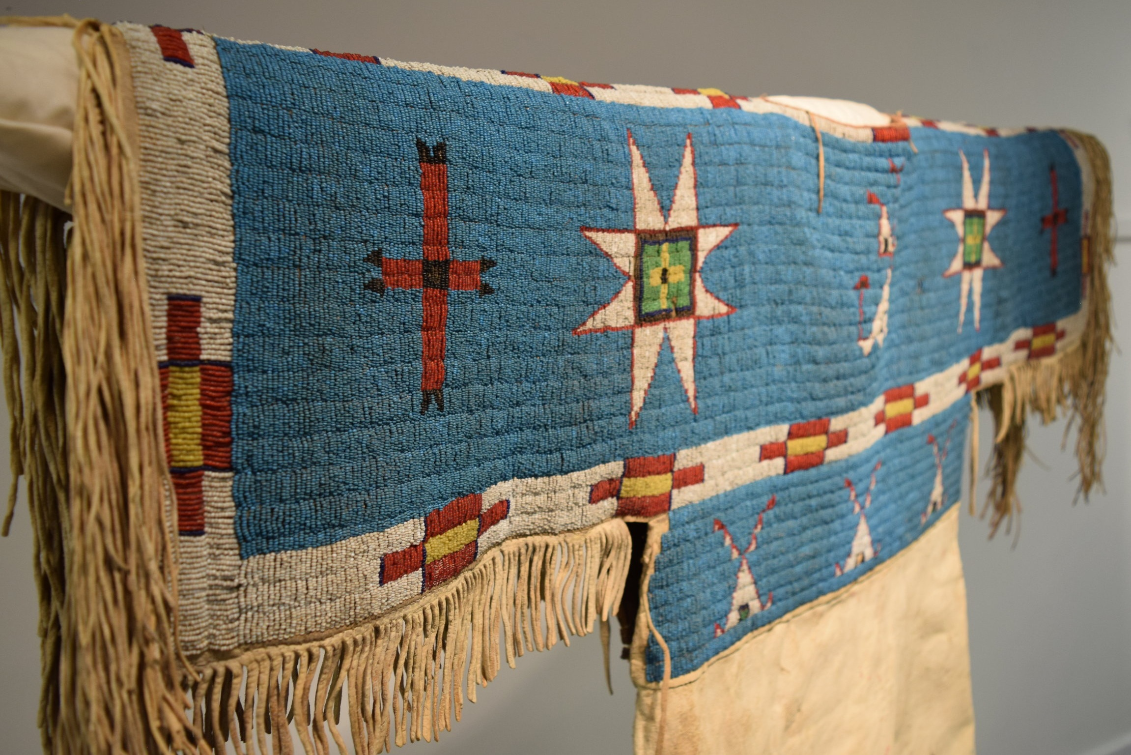 A Continuum of Native Art - Native American art cannot be defined by one aesthetic, medium, or tradition alone. It is constantly changing, reflecting the diverse cultures and experiences of Native artists themselves.Over the last five decades, the Red Cloud Indian Art Show has celebrated the continuum of Native art—and honored the artists who create it.Held on the Pine Ridge Reservation in western South Dakota, the Red Cloud Indian Art Show is the largest and longest-running Native art exhibition of its kind—and one of only a few held in an indigenous community. Hundreds of artists from tribal nations across North America have shared their work through the Red Cloud show, in categories ranging from painting and photography to beadwork and quillwork.But what sets the show apart is its inclusion of all Native artists. Its purpose is to create opportunities for Native artists to explore their talents and share their perspectives, regardless of their previous exposure to the art world. Grounded in community and culture, the Red Cloud Indian Art Show allows the artists themselves to guide the narrative on Native art and indigenous experience.