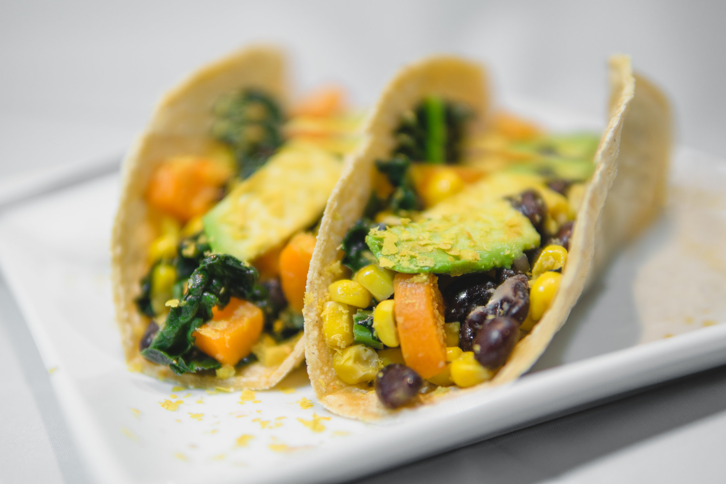 Hippie Tacos - 1/2 an avocado2 corn tortillas1/2 cup cooked black beans1/2 cup of corn1 cooked and diced sweet potato2 tablespoons tahini1 tablespoon nutritional yeast