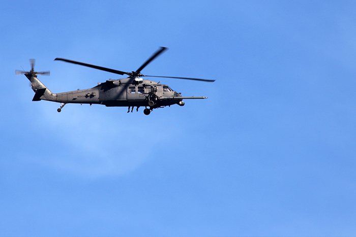 A UH-60 Black Hawk patrols the KSC airspace minutes before the launch.