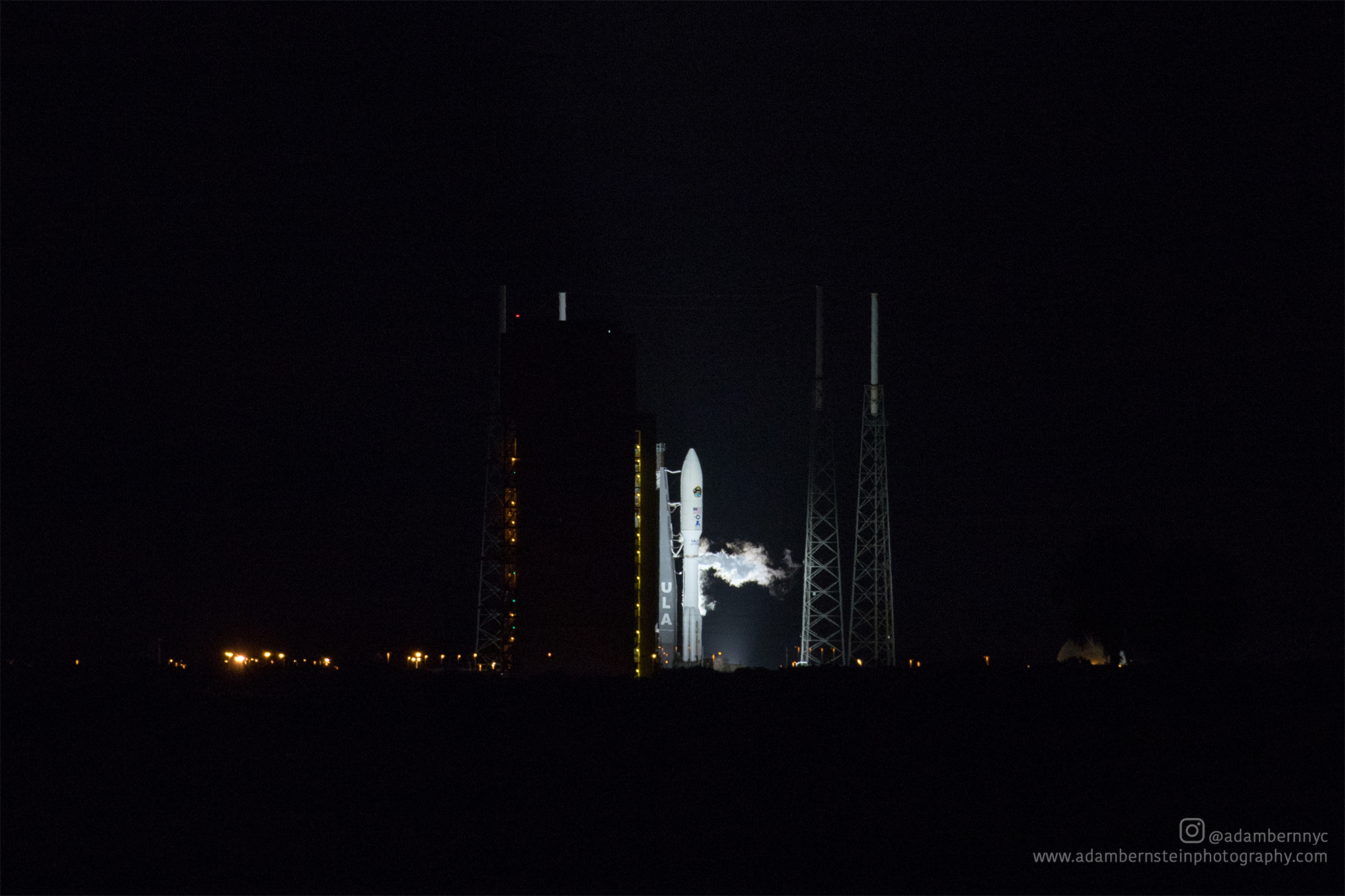 The Atlas V sits on the pad at night ahead of its originally scheduled 5:44 AM EDT launch time.