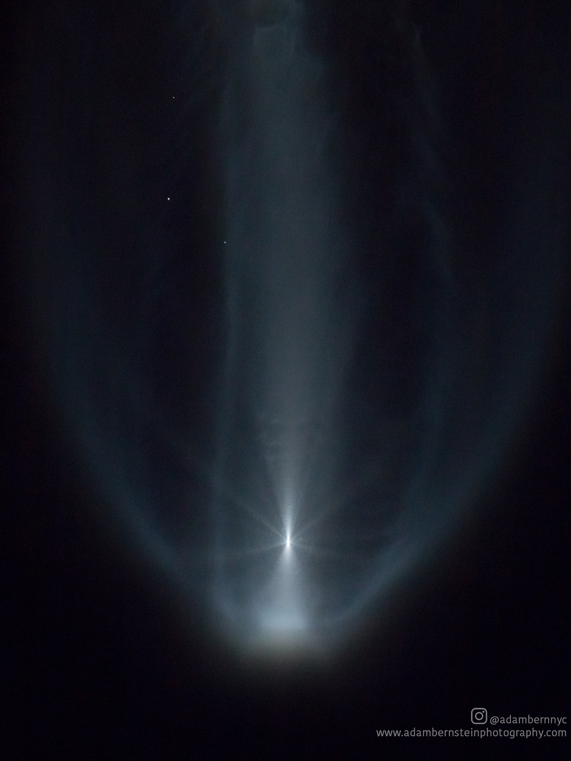 "The solid rocket boosters can be seen falling away from the Atlas V as the ""jellyfish effect"" begins."
