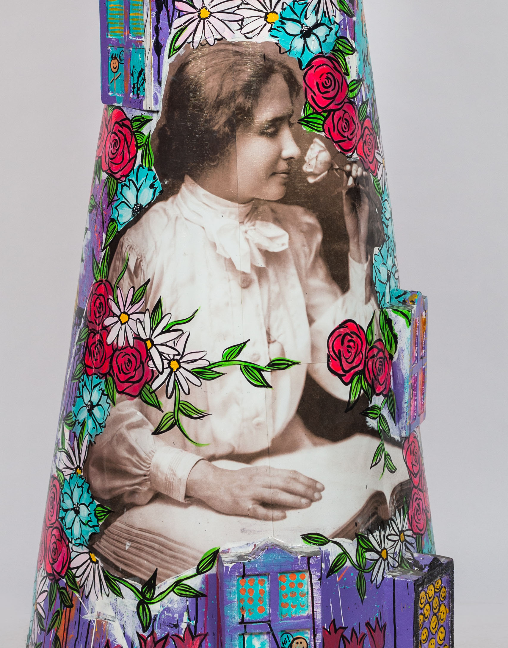 "A photograph of Helen Keller appears on one of 51 lighthouse sculptures that are part of Lighthouses on The Mag Mile celebrating access and inclusion for people with disabilities. This piece is titled ""Lovely Helen"" by artist Jennifer Hiser of 4Everly Adorned."