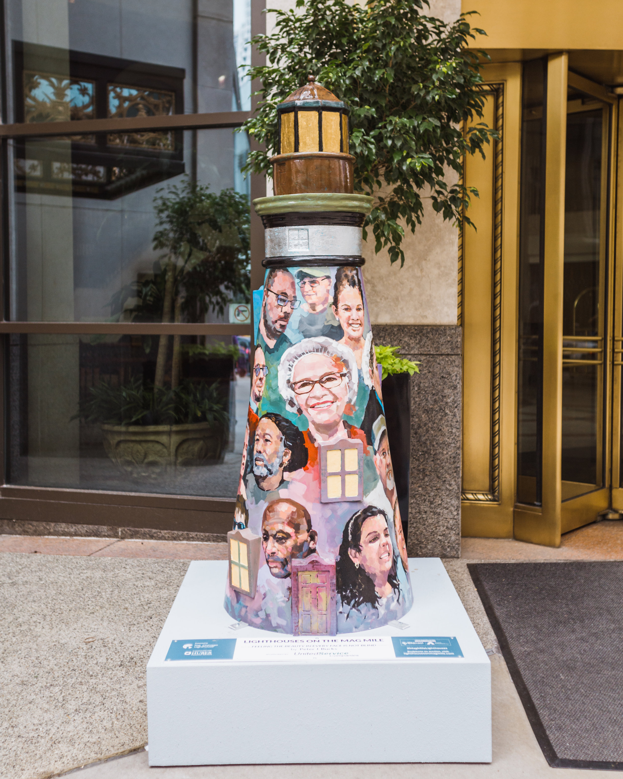 "This lighthouse titled ""Feeling the Beauty in Every Face is not Blind"" by Peter J. Bucks features portraits of many employees of The Chicago Lighthouse who are blind or visually impaired."
