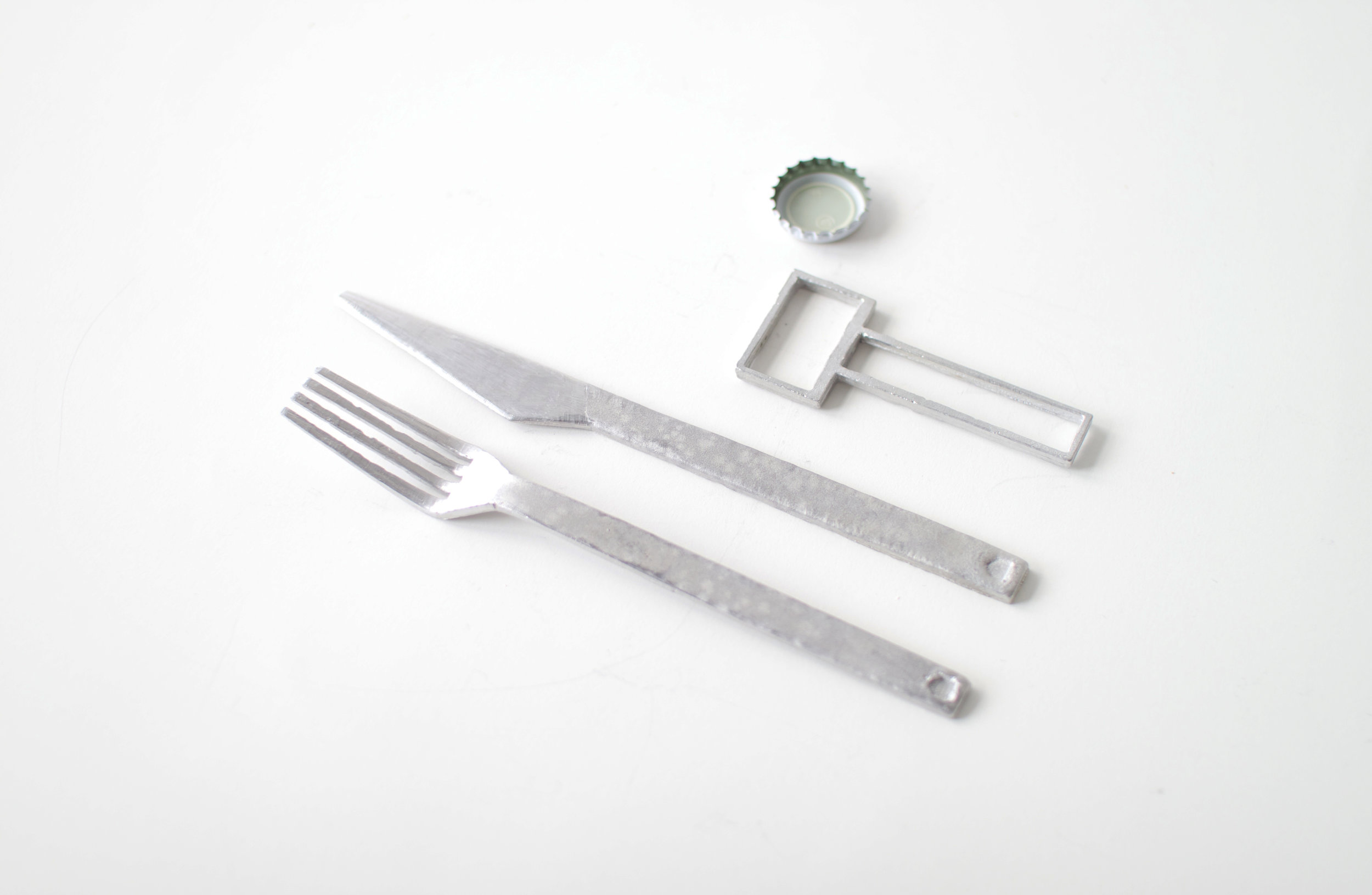 Cardboard cast cutlery and bottle opener