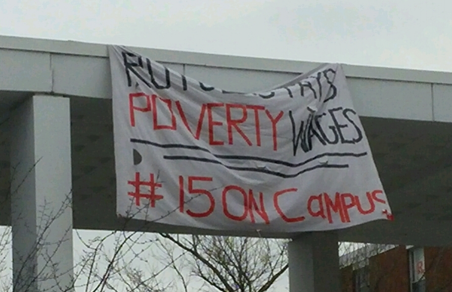 """Banners reading """"Rutgers pays poverty wages #15oncampus"""" appeared Monday at Brower Commons"""