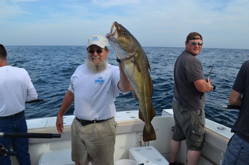 captain Ron s crew with keeper cod.jpg