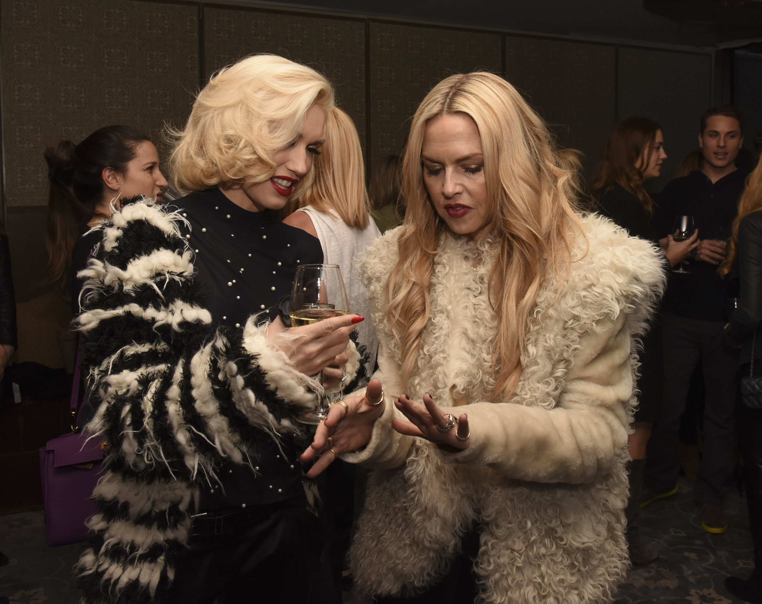 Gwen Stefani and Rachel Zoe admire the rings.