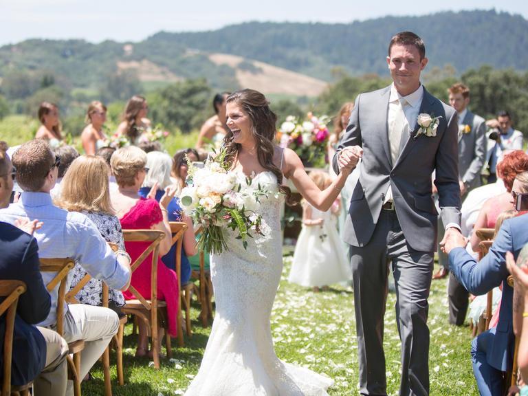 wine-country-wedding-stylemindchiclife-jasminestar-theknot-Wedding couple walking down the aisle at Chateau St. Jean