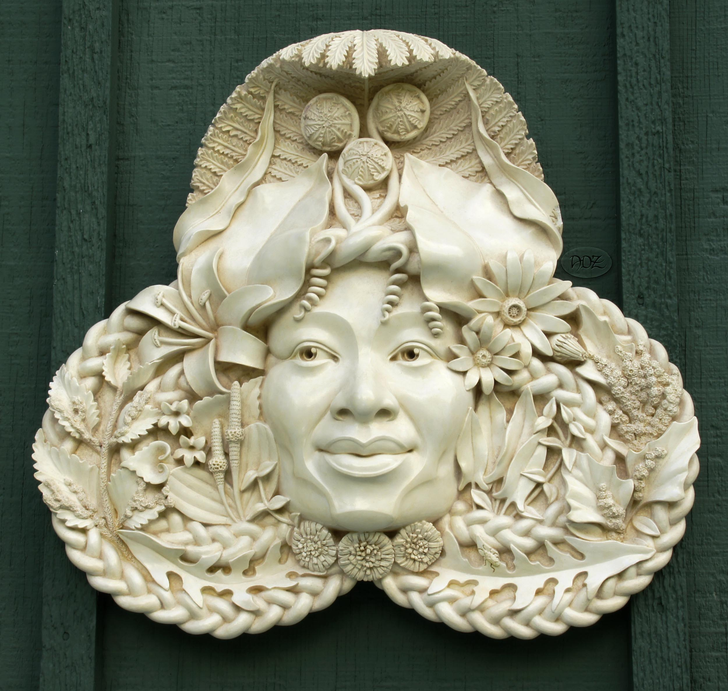 Gaia in cast stone with light Bone finish.