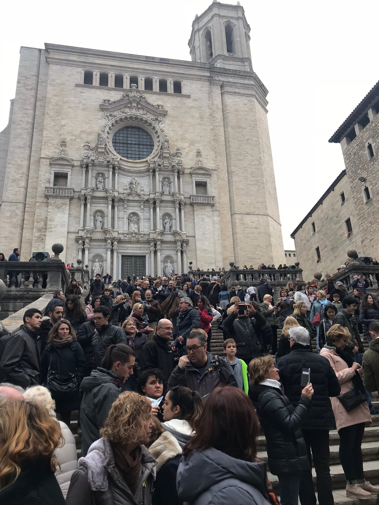 People waiting for the Catholic processional to start outside of Girona's Cathedral