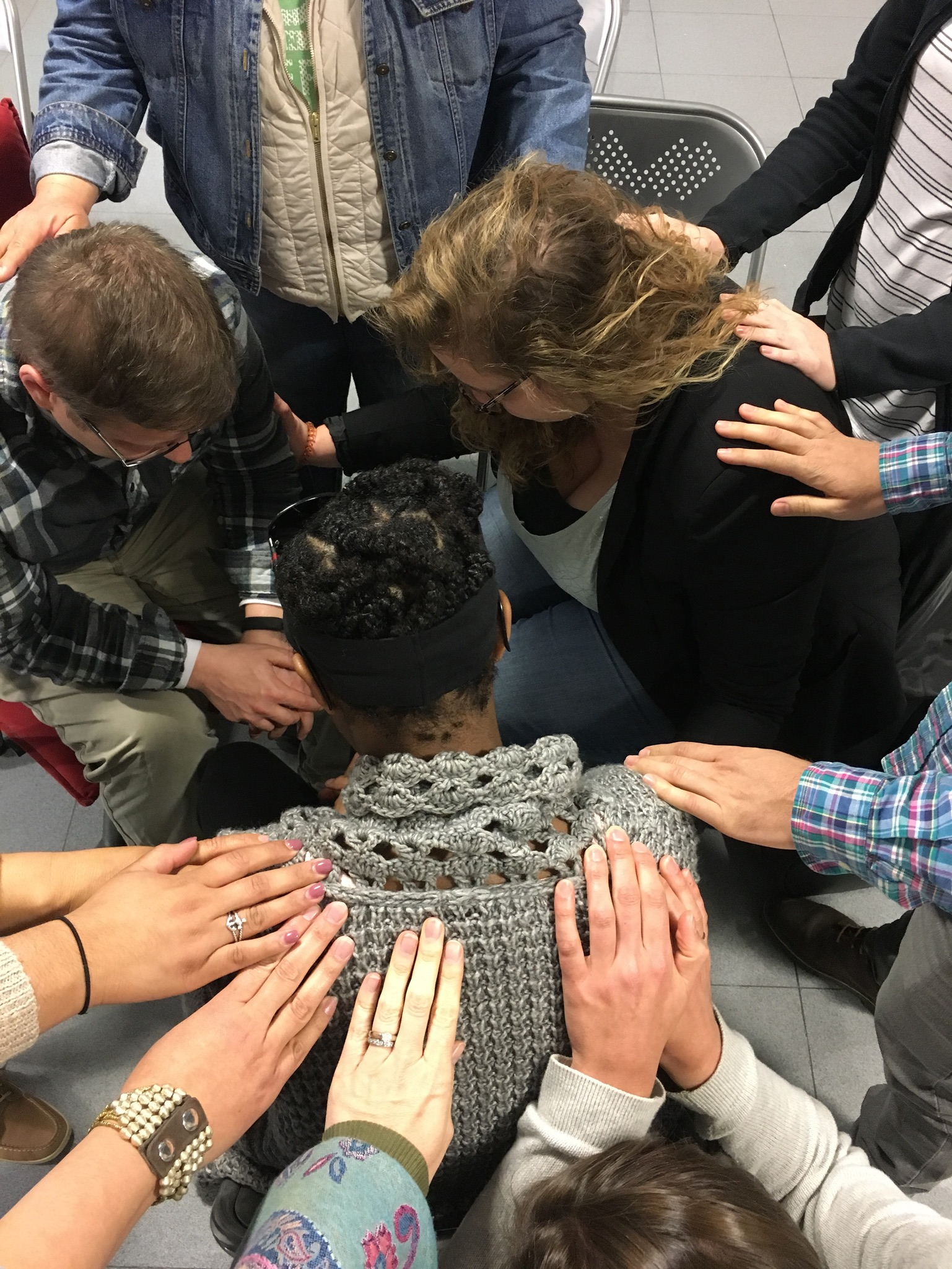 The team praying for the Parnells and Raquel, one of their leaders, on their last night in Spain.