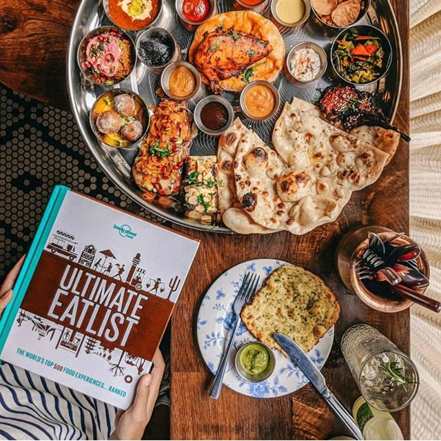 AMAZING COLLABORATION ALERT  Our fave London girl @thecutlerychroicles and Aussie TV chef ( / secret crush) @adamliaw (along with @lonelyplanetfood) have created a TRAVEL AND FOOD BOOK.  The Ultimate Eatlist: The World's Top 500 Food Experiences... Ranked is out anywhere you can pick up GREAT BOOKS 📚🍕🌎 📷 by @thecutlerychronicles from @tandoorchop in London