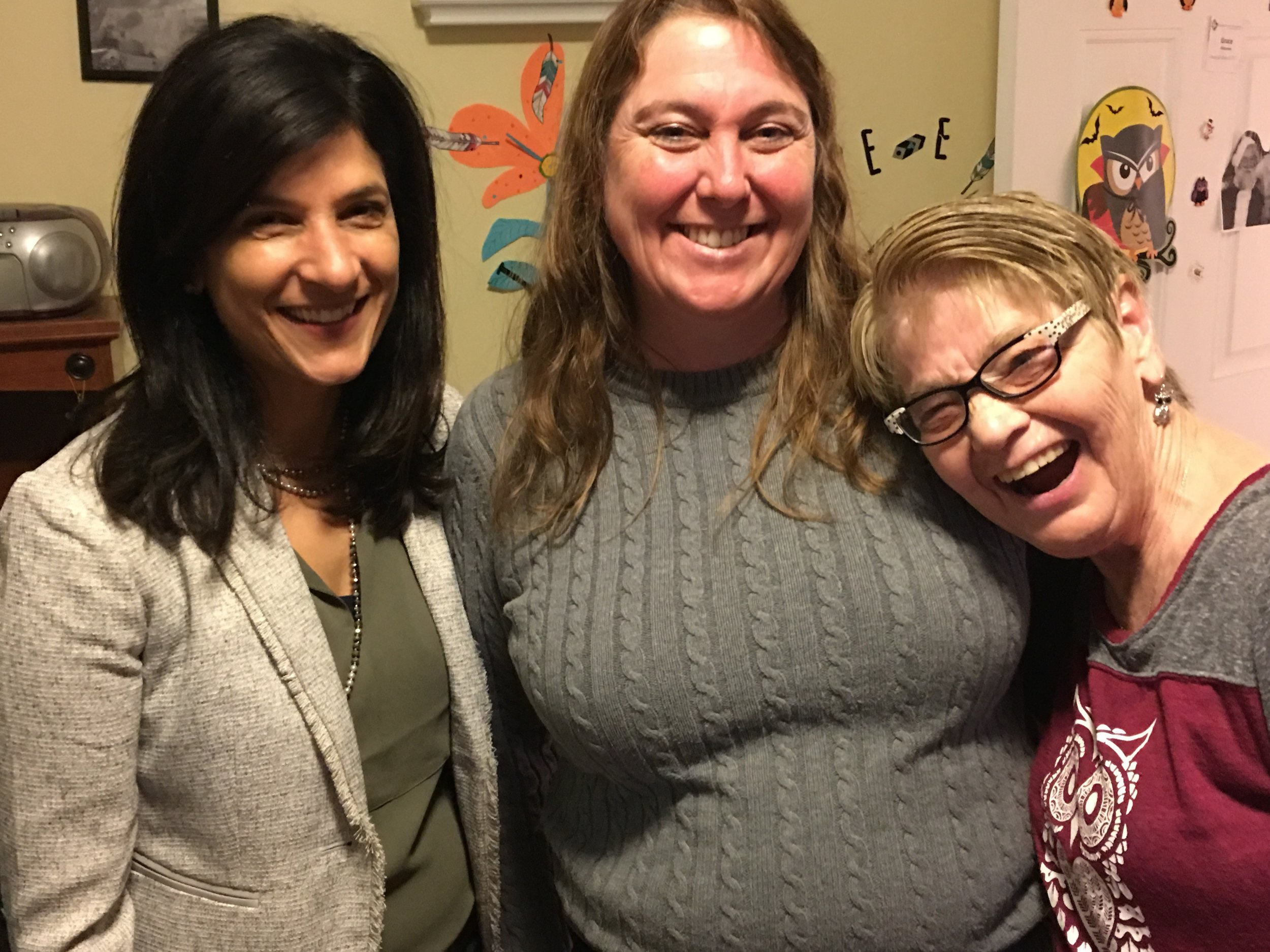 House Speaker Sara Gideon, left, with Amy Davis, associate director of residential services, and a resident of Independence House .