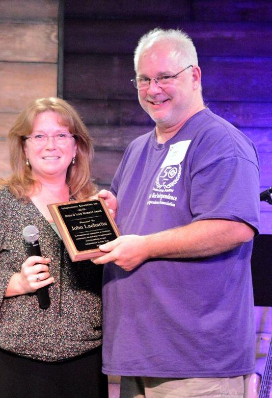 Melissa (no longer staff) John Lacharite award.jpg
