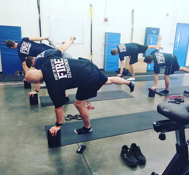Putting the #big #boys through their #tuesdaymotivation #yogafitness . . .#yogaforathletes #yogaforfirstresponders #firstresponders #firemen #firewoman #seattlefiredepartment #firedepartment #stretch #yogafit #yogaseattle #seattlefitness #fitness #fitnesstrainer #fitover50 #fitforlife #wellnessprogram #wellness #corporatewellness #portofseattle @portofseattle @portofseattlelocal