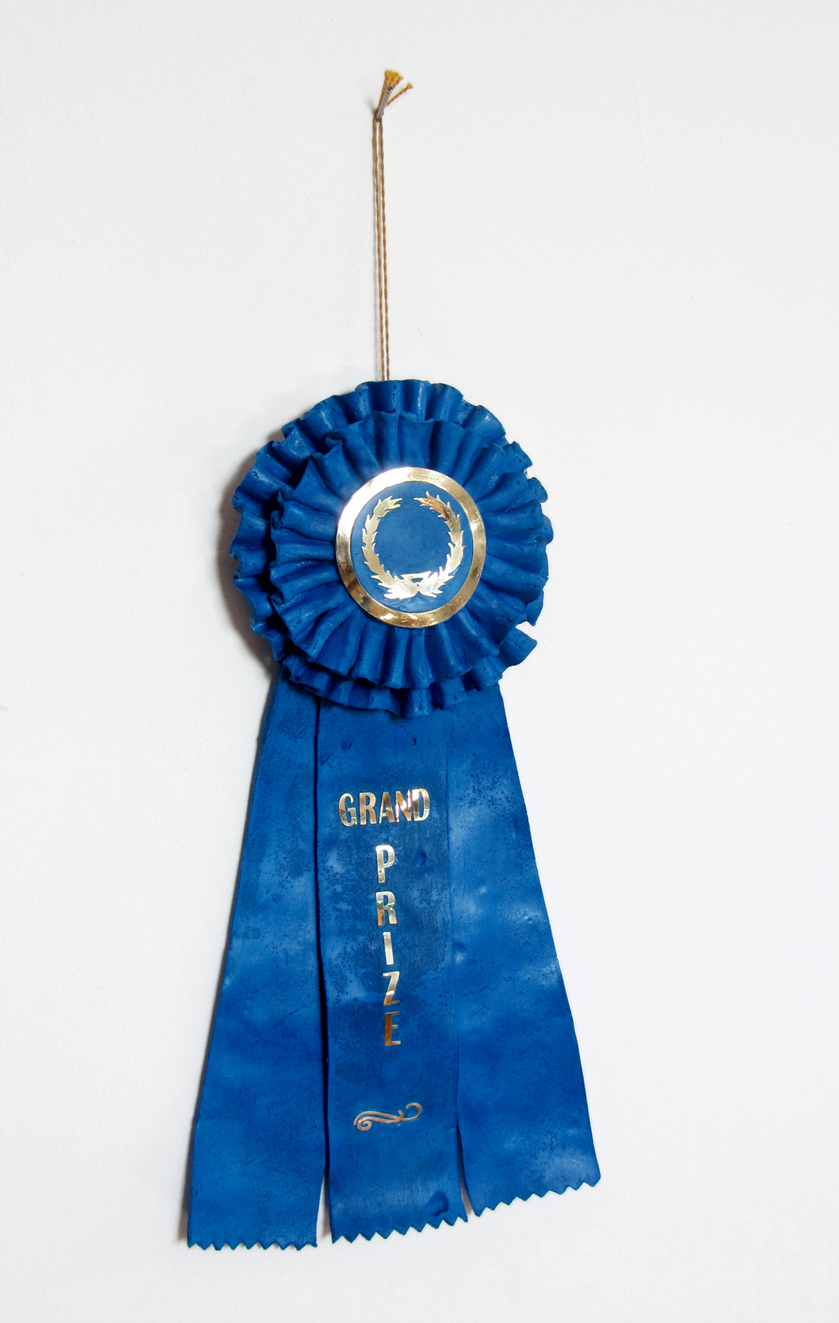 grand prize ribbon   Edition of 30 plastic, pigment, vinyl string & paper  12 X 6 x 2 in