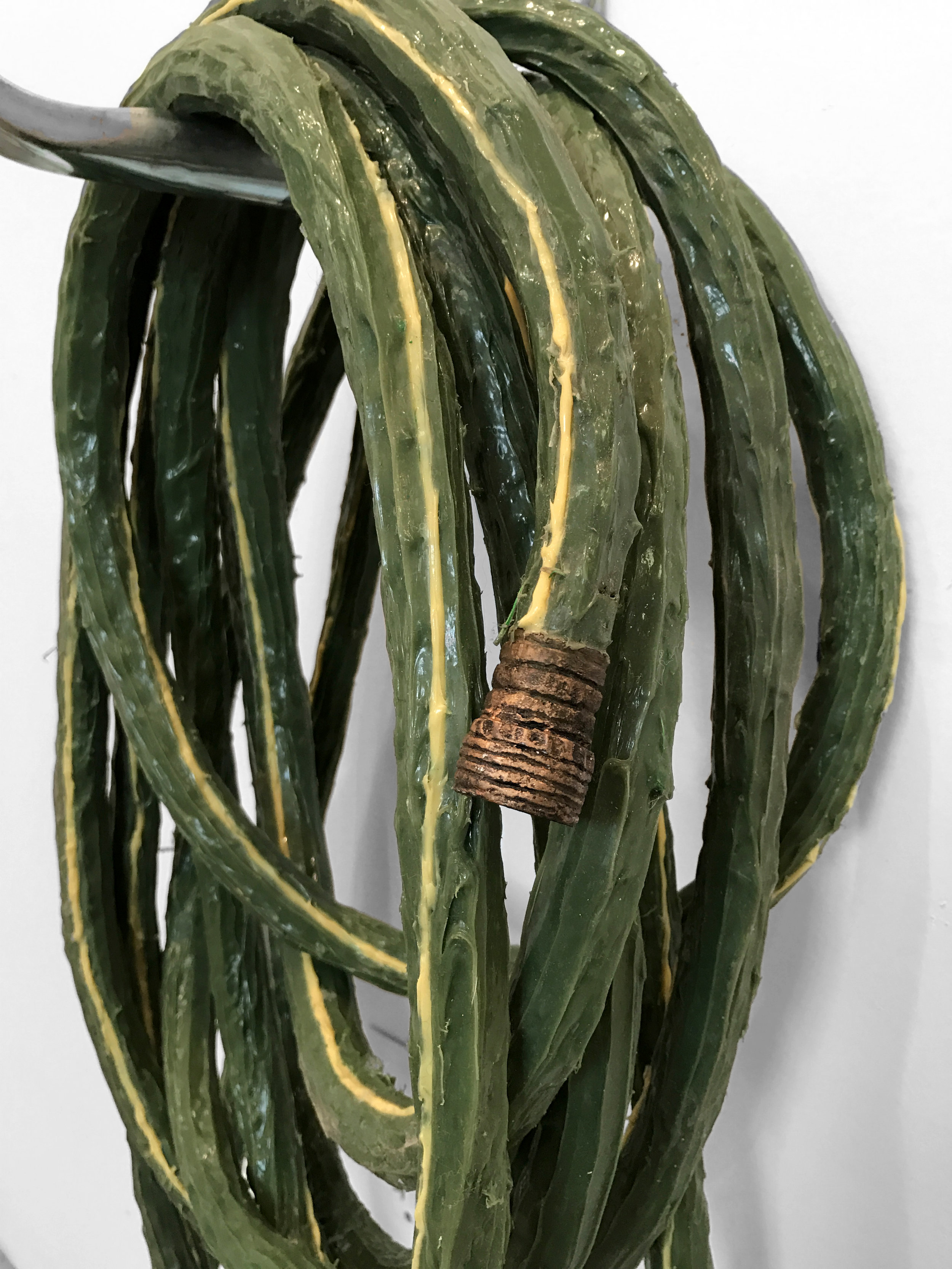 water hose, stripe   rope, silicone rubber, plastic, pigment, aluminum & epoxy putty  1 x 1 in x 50 ft