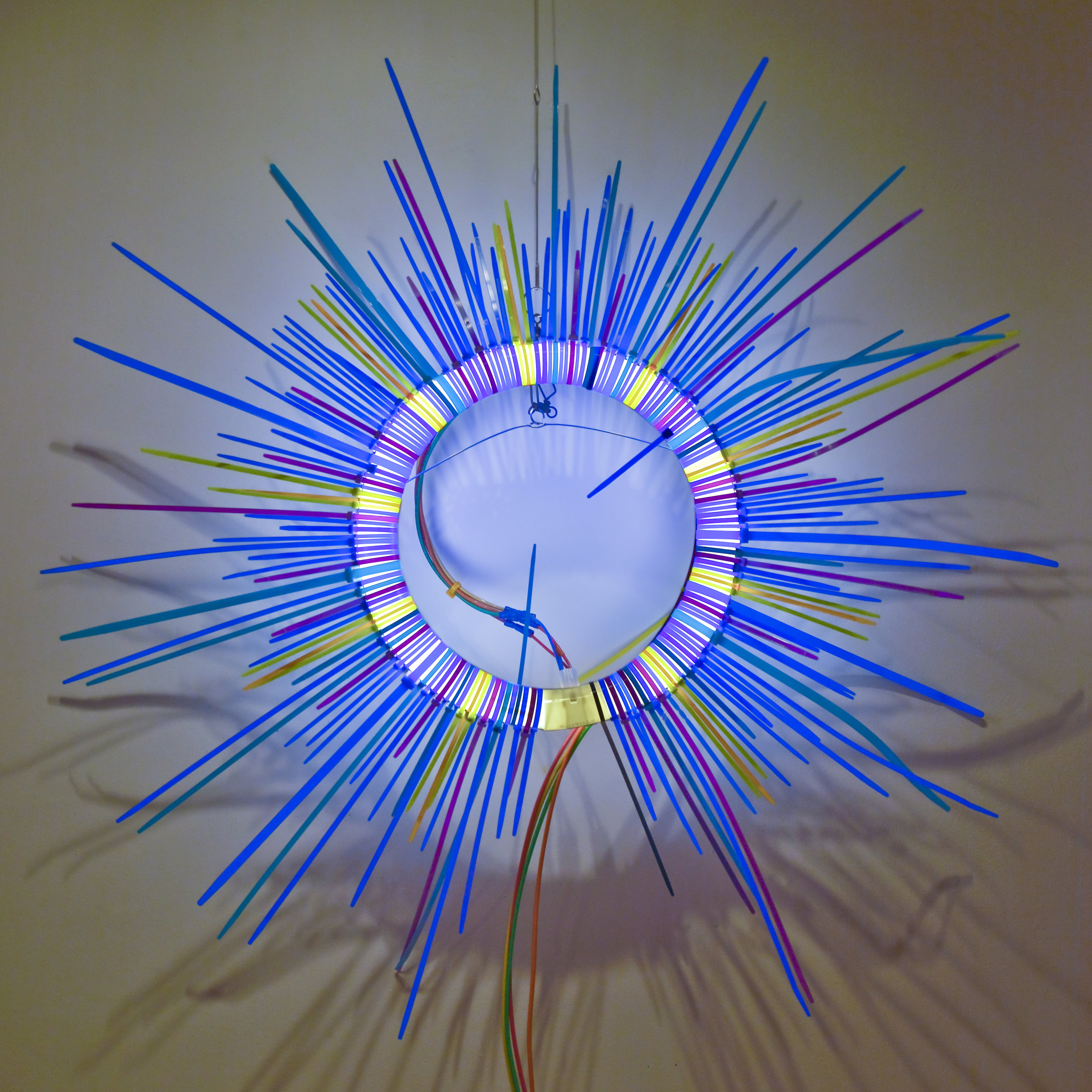 Blue Ring   Fluorescent Lamp, color snap ties, loom heddles and fishing spinners and color wire 12 in lamp diameter 24 in overall