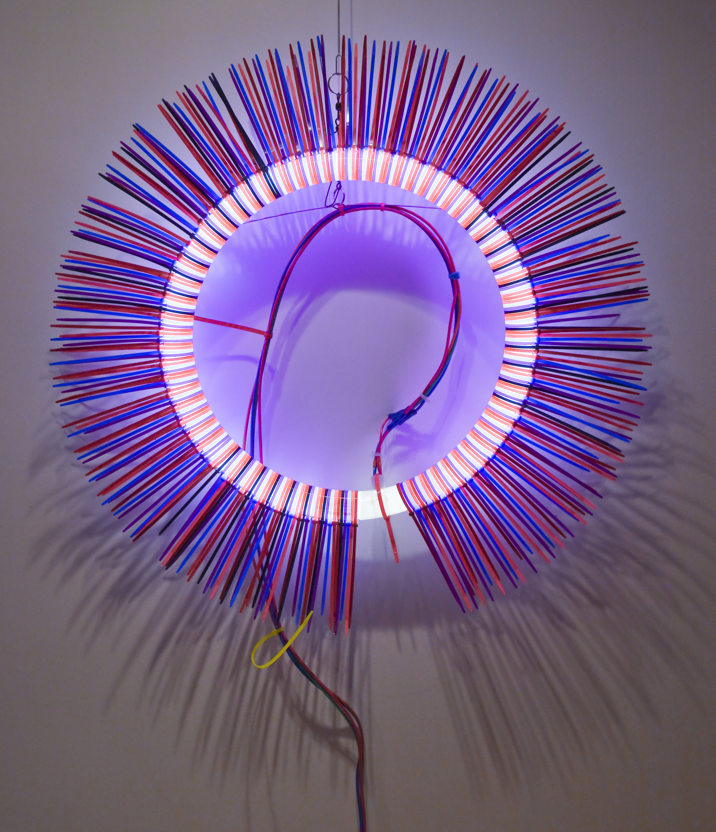 For Someone   Fluorescent Lamp, color snap ties, loom heddles and fishing spinners and color wire 16 in lamp diameter 24 in overall