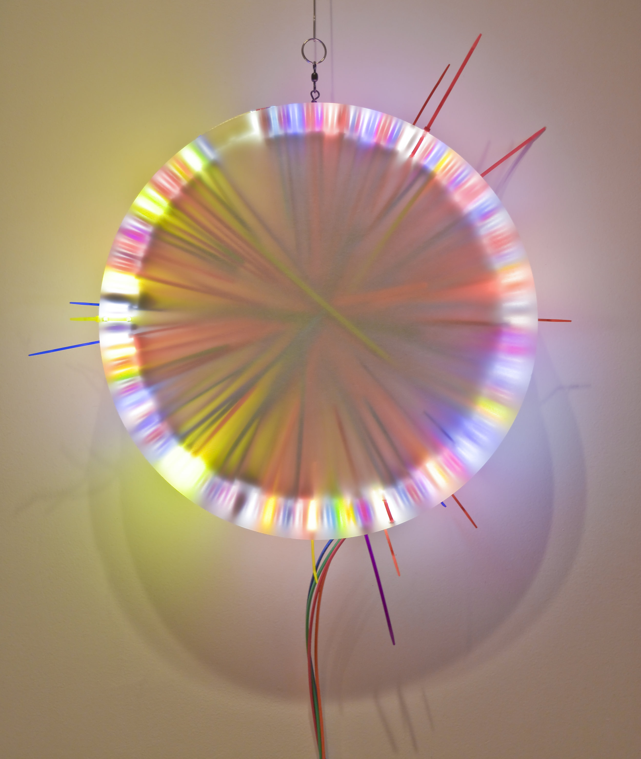 Mixed Pair (Breakup) B   Fluorescent Lamp, color snap ties, loom heddles and fishing spinners and color wire 16 in lamp diameter 24 in overall