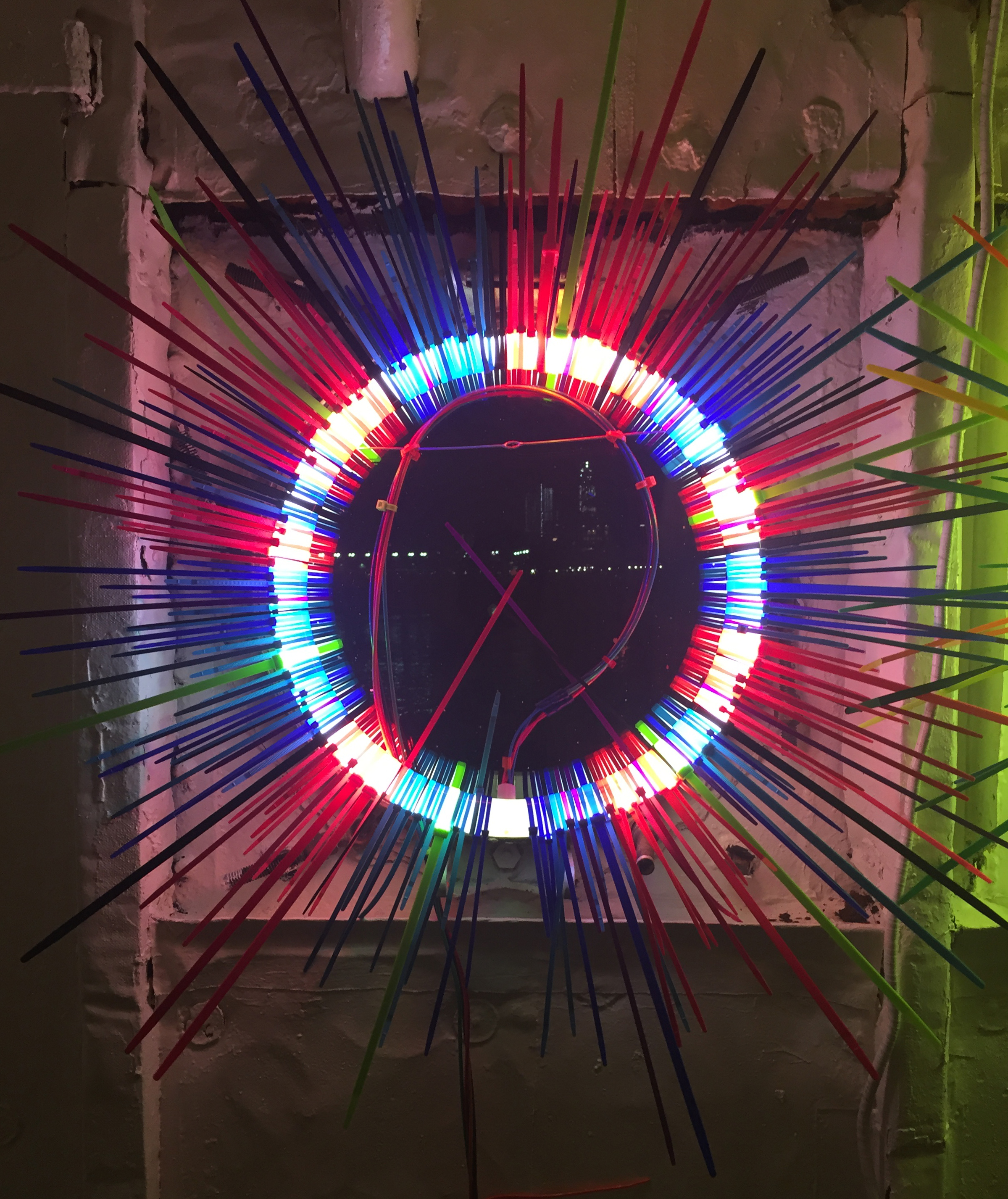 Balanced Equity   Fluorescent Lamp, color snap ties, loom heddles and fishing spinners and color wire 16 in lamp diameter 24 in overall
