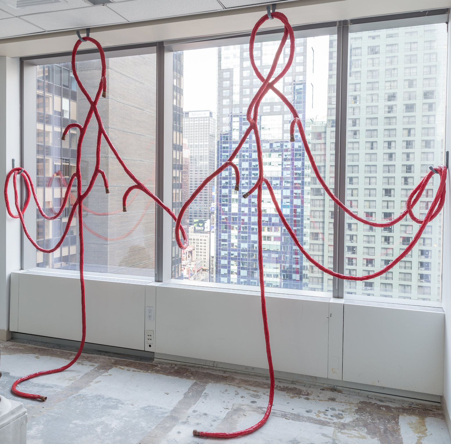 water hose, time traveler, 2017   rope, silicone rubber, plastic, pigment, aluminum & epoxy putty  12 x 7 in x 3 ft