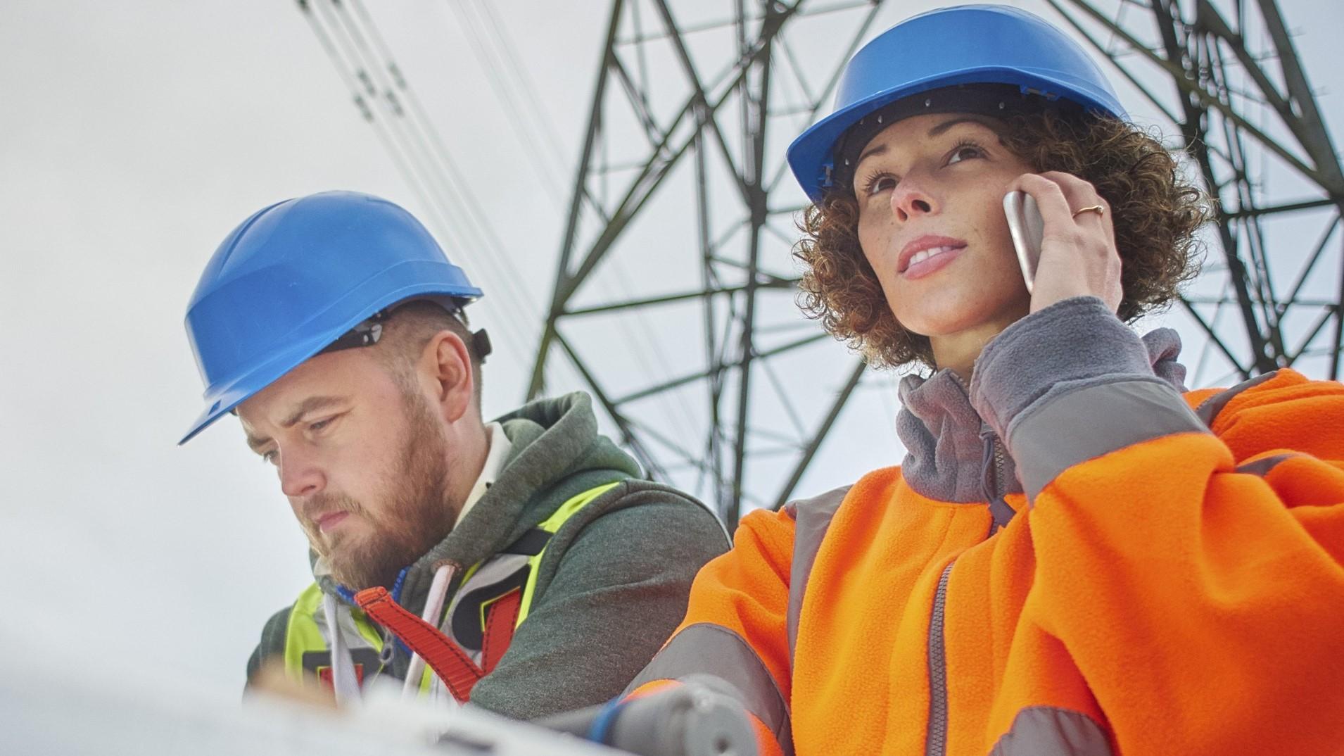 electricity-engineers-beneath-a-pylon-Electricity-Pylon-Working-Industry-Occupation copy - Copy.jpg