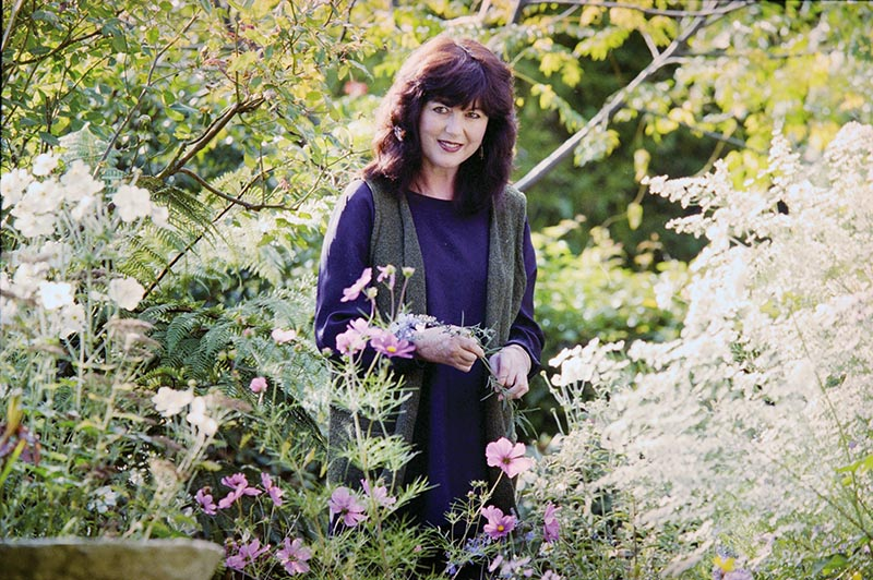 Jane in her garden, where she cultivated flowers specially for her painting, 1997.  I  mage Courtesy of Nelson Provincial Museum