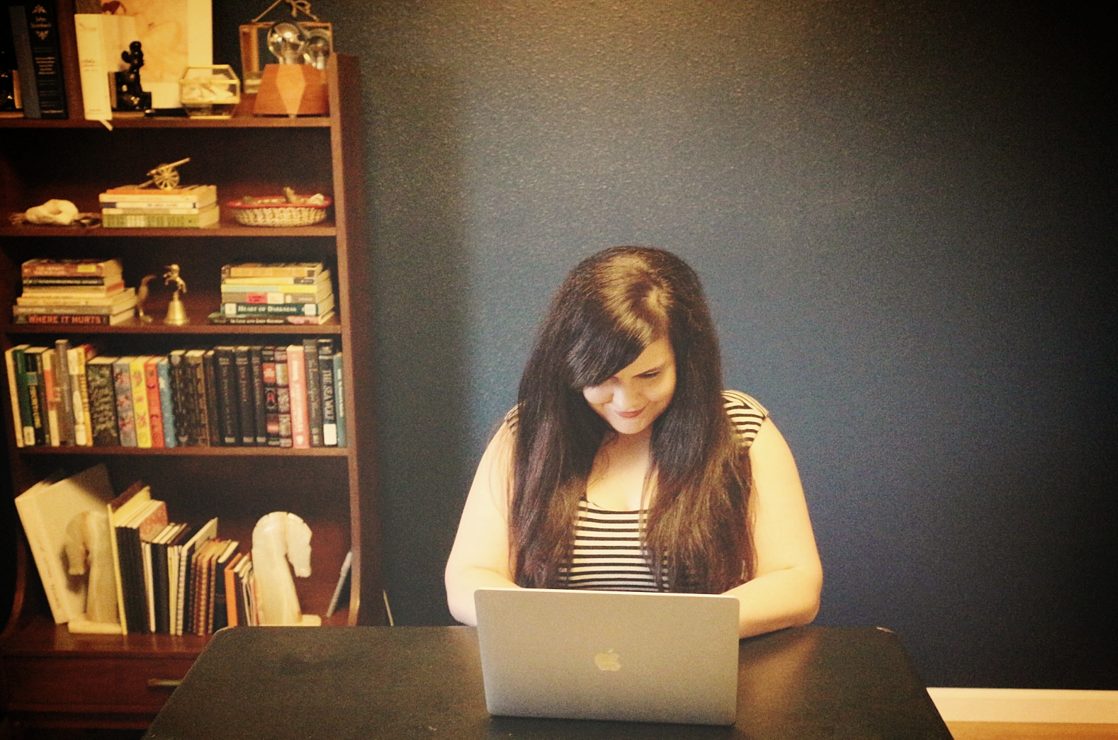 At work in my home office and library.