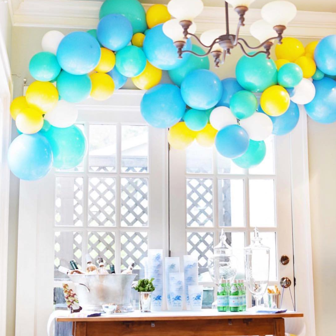"Organic balloon garland installation installed inside of client's home.  What to order: ""Interior organic balloon installation like the derby birthday."""