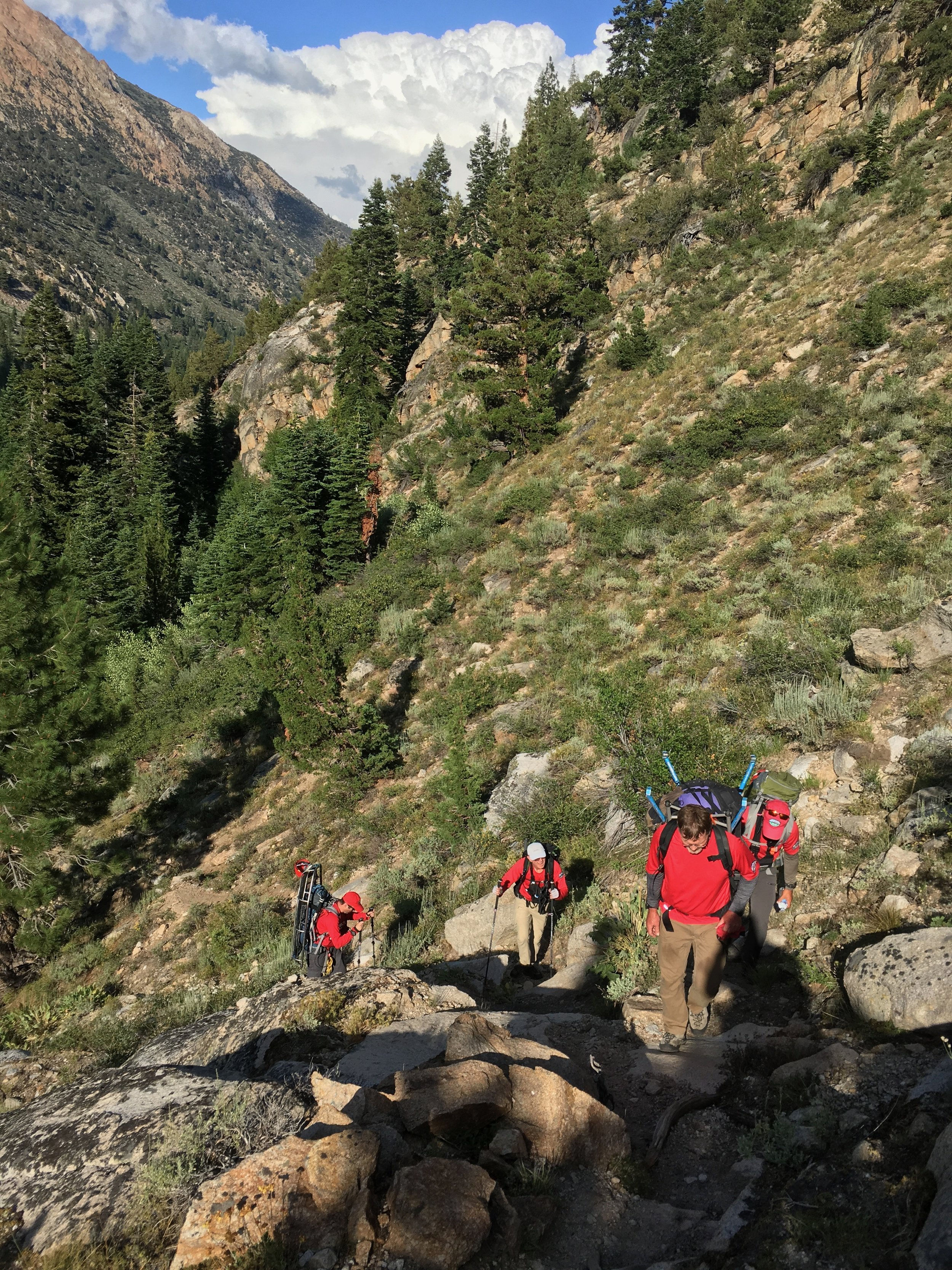 Hiking on the use trail in Little Slide Canyon. Image by M. Quiring